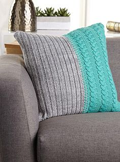Kas Australia at Simons Maison. We love knits that add texture and warmth to every room in the house. This piece combines braided cables and graphic ribbing in bright contrasting blocks for a refreshing pop of colour! Solid, light grey underside in a fine knit Washable with removable cover and a zip on the edging 50 x 50 cm