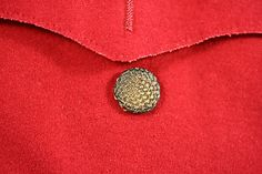Detail, pocket flap, Man's Suit, British, 1750-75, wool, silk, gold. Metropolitan Museum of Art.