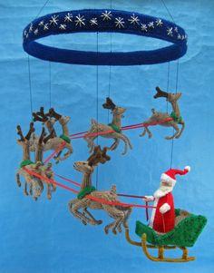 Knitting pattern for Santa Mobile by Alan Dart
