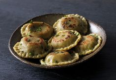 Roasted mushroom and chevre ravioli with thyme and garlic scapes