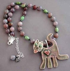 Cat lover necklace with removable pendant to wear as brooch.  Handmade porcelain cat sculpture with pretty pink heart and face details. Turquoise and mauve jasper gemstone necklace.  One of a kind.  For Love of a Dog