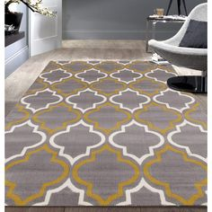 This delightful rug is unique, stylish and ready to accent your decor with authentic elegance. This rug features bold colors and Moroccan, contemporary style to coordinate with any interior design. Th