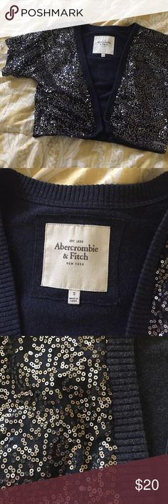 Short sequined navy sweater Abercrombie sweater, short, navy and covered in silver sequins.  Great for over a tank with jeans or with a dress at a fancy occasion.  Size small, comes to natural waist Abercrombie & Fitch Sweaters Shrugs & Ponchos