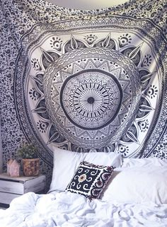 "Top off your bed or accent a wall with this unique boho tapestry, featuring a bold black and white mandala pattern on soft white fabric. This tapestry also doubles as a picnic blanket, perfect for festivals, beaches and more!Each tapestry cover is unique; Color and pattern placement will vary Approx. 96"" L, 80"" W Care/Washing Instructions: Hand wash cold, separately. Hang/Lay flat to dry 100% Cotton Handmade in India"