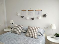 I decorated a No Headboard Bedroom Wall with printables, hangers and a garland