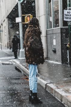"Fight off the ""brr"" with a pair of boyfriend jeans strategically cuffed above an ankle boot oh, and a fur (faux) coat. Stay warm, stay stylish."