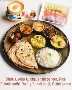 North Indian lunch menu with dhokla, salad, aloo kulcha, shahi paneer, rice, dal fry, pakodi kadhi, bhindi subji, pickle, dahi and gulab jamun. Check the links for recipes. This post is just idea on how to prepare the menu, for recipe and method, check the respective links given.