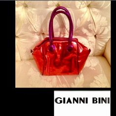 Purple&Red❤️ Metallic Purse by Giannini Bini Genuine Faux Metallic Red and Purple LeatherBy Giannini Bini❣6in high x 9in wide❣can add a chain shoulder strap❣or carry as a clutchBundleTradesOffer button is preferred via all offers❣New Never usedThank You Gianni Bini Bags Clutches & Wristlets