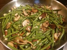 Green Bean Almandine: Trim the green beans (450g) and simmer for 6 to 7 minutes. Melt 60g butter in a frying pan and saute the 225g of shiitake mushrooms until brown. Add salt (half a teaspoon) and 30g sliced almonds. Add the beans to the frying pan and toss well. Cook for 4 more minutes.