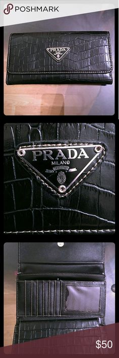 Classy Chic black leather Prada wallet! This elegant statement wallet was used with lots of love.. but as a Mom of five I'm cutting down on all extras and clearing out my closet, And getting rid of some of my most beautiful things!!  Hoping they will find a new home that will love them like I did.  * There's a small tear inside of wallet on both sides .. (see the pictures where it's open) but not noticed until you really look for it, and simply gorgeous on the outside in every way. I have…