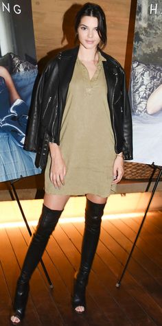Kendall Jenner celebrated mom Kris Jenner's magazine cover in an olive green collared tunic that she toughened up with a black moto jacket and thigh-high open-toe boots.