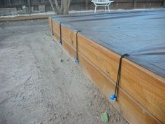 tarp ties on sandbox by Giltronix, via Flickr