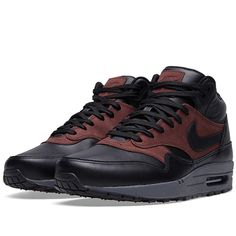 A new take on one of Nike's most beloved silhouettes, the Air Max 1 Mid FB incorporates a mid height collar into Tinker Hatfield's classic design. p> Leather Uppers Sparkling Mudguard Panels Mesh Toe Box Visible Air Sole Unit Rubber Outsole Style Code: 726411-002