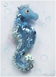 Blue sea horse felted brooch