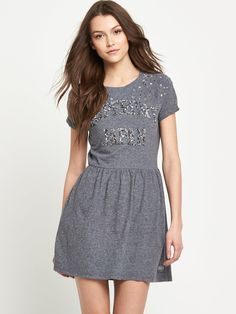 Superdry Shimmer Raglan Dress Giving an off-duty staple a glitzy twist, Superdry have added sequins to this raglan sleeved dress for a little touch of shimmer when it comes to your summer styling. Laid back and casual, this frock will rock your off-duty weekend looks this season.Just add your go-to plimsolls and a Superdry zip up hoodie to throw on when the temperature dips.Washing Instructions: Machine WashableCottonBeaded logo printLength 31in