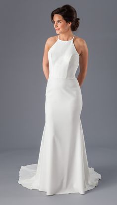 Jacquelyn Wedding Dress | Kennedy Blue | This beautiful crepe wedding dress is lightweight and has a high neckline with an open back that is absolutely stunning.