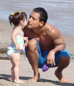 Mario Lopez takes his daughter Gia to the beach on July 15, 2012
