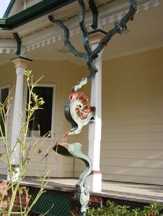 Multiple gutter Water Wheel and Frog downspout ~~~ These copper downspouts were designed and crafted by Vladimir Sumchecko, a Ukrainian immigrant located in the Pacific Northwest. Imagine if it made music?