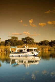 Old Willow No 7 - Houseboat Charters. Captain your own river cruise adventure. Hire a self-drive houseboat and navigate the Vaal River. Restaurants, spas, golf courses and casino. Fishing, watersports, birdwatching. Just 1 hour from Joburg.