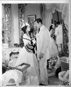 Scarlett O'Hara and Rhett Butler on their honeymoon after Scarlett's shopping spree.