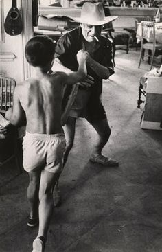 Picasso playing with son Claud.