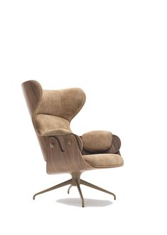 Wingback Chair named Lounger and designed by the spanish designer jaime hayon for BD barcelona. The lounge chair has a hood and optional foot rest. It's a part of hayon's 'showtime' collection. The wingback chair emphasizes a contrast between monocolor finishes and high quality upholstered fabric and leather.