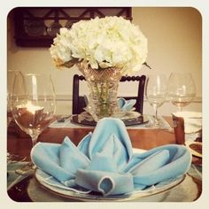 love the napkin color and how they folded it! also beautiful and simple flowers in a delicate vase.