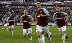 Marko Arnautovic celebrates scoring what proved the winner for West Ham against Chelsea
