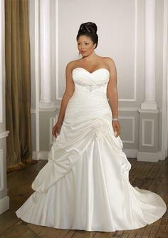 Plus size wedding dress, wedding gown for the full figured or curvy woman. Flattering and slimming satin