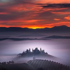 Sheets of fog over Tuscany, Italy. Photography by © Alberto Di Donato. #OurPlanetDaily