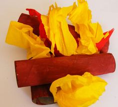 """Cute little indoor campfire made of paper towel rolls and crepe paper by Fun Mama. This would be fun for a little indoor """"camp out"""" slumber party in the middle of winter."""
