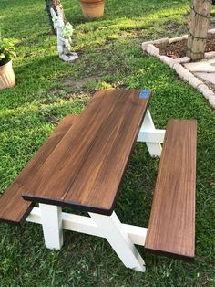 "DIY Farmhouse kid's picnic table. 2x8's and 2x4's. 22.5* miters, 36""W 20.5"" Legs, top cross bar 14"", little over 2 feet tall overall. Behr, exterior stain, table top. SM Dover White, Chalk paint, legs. Turned out super cute!"