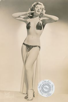 Tina Christine. Tina started working the Hirst Burlesque Circuit in 1953. Prior to that she was a chorus girl at the Gayety Theater in Baltimore, MD, and had worked with producer and choreographer Hattie Flaig to develop a solo routine.