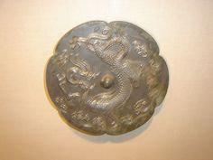 A Chinese six-lobed bronze mirror with a dragon decoration, from the Tang Dynasty, century. Japanese Dragon, Chinese Dragon, East Asian Countries, Bronze Mirror, Legendary Creature, Animal Totems, Ancient Symbols, Chinese Antiques, Conch