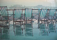 'Precipitation Within Sight' by the local artist Philip Dunn of deck chairs on a wet Brighton promenade with the Palace Pier in the background Shipping Forecast, City By The Sea, Rain Photo, British Summer, Beach Color, Brighton And Hove, Deck Chairs, Wet Look, England Uk