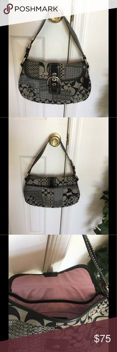 Black/Grey Coach Bag Beautiful  Authentic Black/Grey Coach Bag with silver metal accents.  Large opening on rear of bag, 2 section divider inside with one zipper and 2 slots inside.  Very spacious for it's measurements. Excellent condition inside and outside great used condition. Coach Bags Satchels