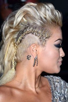 Rad Or Bad: Braid Piercings #refinery29 www.refinery29.co... Look closely at Rita Ora's undercut twist and you'll notice it's covered in piercings, proving that a dressy hairstyle can be a little bit tough — and still look great.
