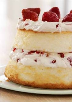Strawberry & Cream Angel Cake – Juicy ripe strawberries and luscious creamy filling are layered between airy angel food cake in this delicious dessert recipe. If that weren't heavenly enough, it's better for you, too. Strawberry Angel Food Cake, Strawberry Recipes, Strawberry Summer, Strawberry Patch, Just Desserts, Delicious Desserts, Yummy Food, Sweet Recipes, Cake Recipes