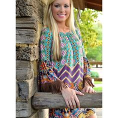 009 ☂off the shoulder boho mini dress☂ Super cute bohemian dress with bell sleeves and fringe brown edges. Wear it with heel boot sandals anything will get you compliments.           044 Dresses Mini