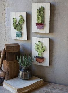 set of 3 cactus string art on wooden plaques The cactus trend isn't going anywhere! With this set of string art cacti on wooden plaques, we added a new spin on it. The plaques can be hung on the wall but are also thick enough to be able to sit alone Cute Crafts, Diy And Crafts, Arts And Crafts, String Art Diy, String Crafts, String Art Tutorials, Cactus Care, Cactus Cactus, Cactus Flower