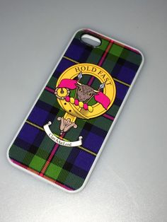 Rubber sided cover for iPhone 5 and 5s featuring crest of clan Macleod and tartan.