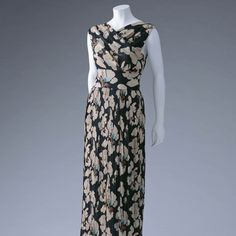A printed evening dress designed by Elsa Schiaparelli for her own brand. Printed dresses became a trend in the 30's and Schiaparelli became known for them. This one is made from silk. Retrieved from KCI.
