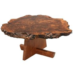Walnut root coffee table  This reminds me of a coffee table my parents had before this type of thing was cool!