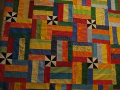 This is Dr Toneys quilt- only colors are greens and browns, pinwheel pattern doesn't stick out so much that way