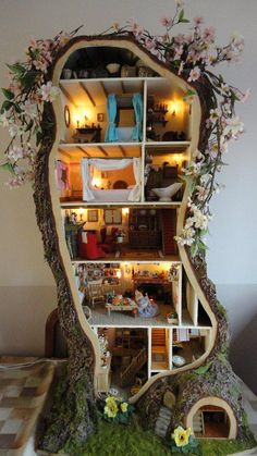 "The miniature tree house for mice was created by Maddie Brindley and was inspired by Crabapple Cottage drawn by Jill Barklem in her book ""Spring Story"".  The frame and bark are completely hand made from scratch. kinda reminds me of dinner for shmucks but this is cool!"
