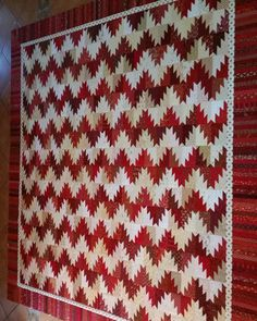 Red and white Scrappy Mountain Majesties flimsy is finished. It's a Bonnie Hunter free pattern. #scrappymountainsmajesties #bonniehunter #scrappyquilt #redandwhitequilts