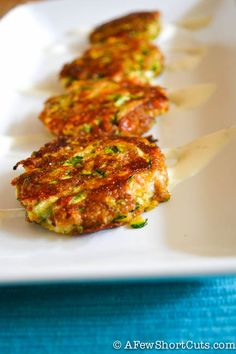 Cheesy Zucchini Cakes - will double recipe and serve as a meal with home made marinara sauce.  Everyone raved about these, served with marinara sauce instead of ranch.