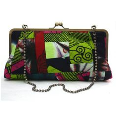 African Print Patchwork Clutch by Urbanknit  A mad mix of Ankara and Adire in a rather large clutch purse, complete with a cool beaded metal strap. Definitely a OOAK (one-of-a-kind) Learned that word on Etsy!  #Clutch #Patchwork #handmade #urbanknit #purse #largepurse# ankarabag #Ankara #Handbag #Green #Blue #Pink #Red #AfricanFabric #AnkaraFabric #Adire #TieDye #Batik