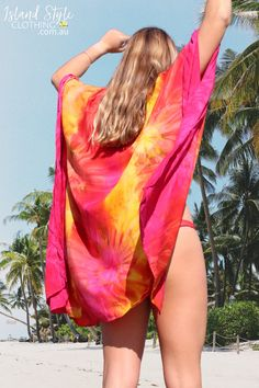 Keep covered and stylish in our Sunrise Tie-Dye Kimonos. Featuring batwing half sleeves, and a relaxed open front silhouette that falls into a mid-length hemline. Layer it over your swimsuit at the beach or pair it with denim for everyday wear. Oversized, relaxed fit and available in other colours! #kimono #beachcardigan #bikinicoverup #swimsuitcoverup #beachwear #cruisewear #tiedye #festivalclothing #festivalcoverup #summer #islandstyle #tiedye #holidaywear #beachcover #rainbow #sunrise #orange