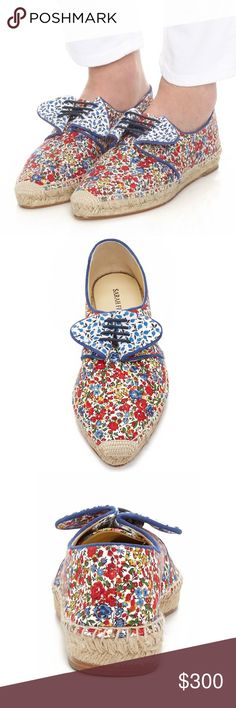 Sarah Flint Elena Espadrilles A fold-over panel and laces accent these floral canvas Sarah Flint espadrilles. Braided jute sidewall. Leather sole. This espadrille by Sarah Flint is rendered in floral linen and features a lace up closure with blue floral lepel inspired detail. Lace up Material: Linen Color: Red floral print Made in Spain. Measurements Heel: 1in / 25mm.                                                                     BRAND NEW WITH TAG Sarah Flint Shoes Espadrilles